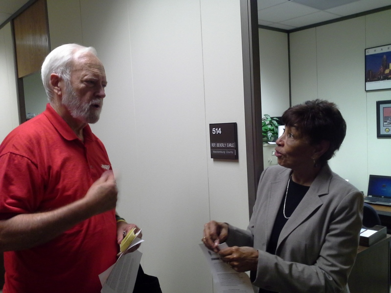 AARP Volunteer Tom Murdock advocates for funding and services for seniors in Mecklenburg County with Representative Beverly Earle.